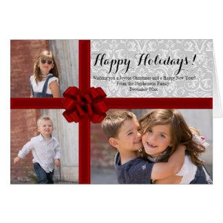 Foto roja del navidad del arco de la cinta tarjeta pequeña