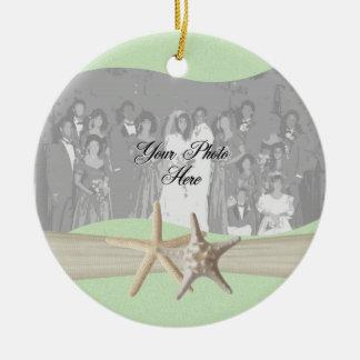 Foto verde clara de las estrellas de mar adorno navideño redondo de cerámica
