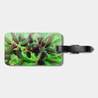 Foto verde roja del anenome del mar etiquetas para maletas