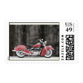 Foto vieja de la motocicleta del color sello postal
