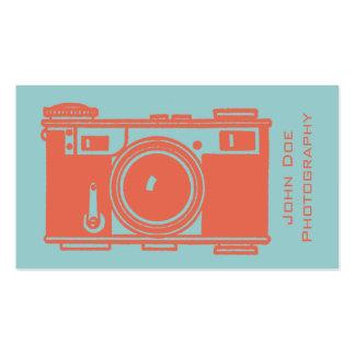 Fotografía anaranjada retra de la cámara de la tarjetas de negocios