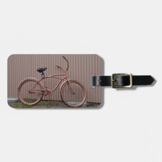 Fotografía de bronce de la bicicleta etiqueta para maleta