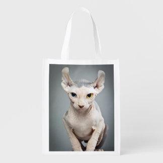 Fotografía del gato de la esfinge del duende bolsas de la compra