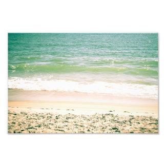 Fotografía en colores pastel de la playa de las on cojinete