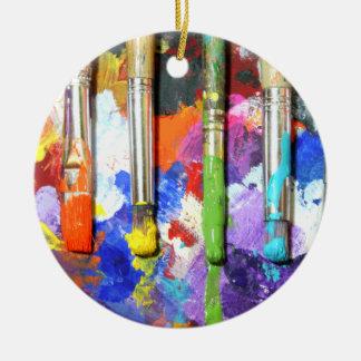 Fotografía en curso de la brocha de los arco iris adorno navideño redondo de cerámica