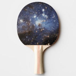 Fotografía estelar del espacio del cuarto de niños pala de ping pong