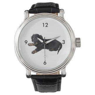 Fotografía negra del perrito de cocker spaniel del relojes