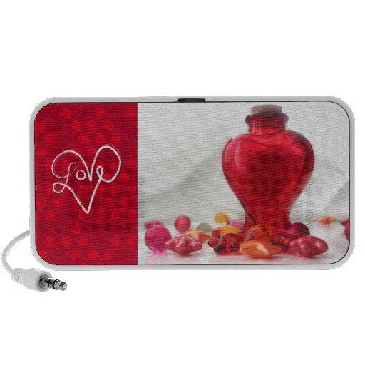 Fotografía roja romántica de la botella del corazó iPod altavoz