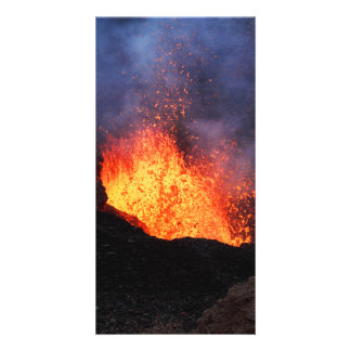 Fountain lava eruption from crater active volcano card