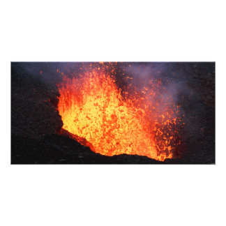 Fountain of hot lava erupts from volcano crater card