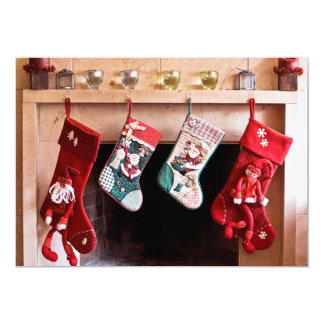 Four Christmas stockings hanging on fireplace Card