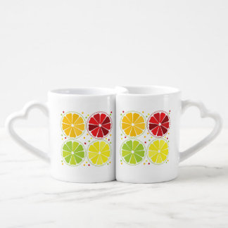 Four citrus fruits couple mugs