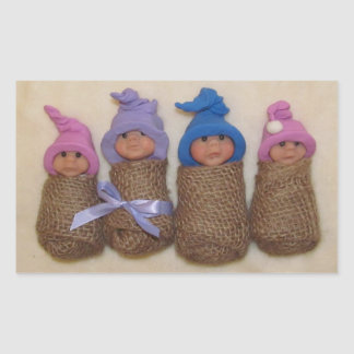 Four Clay Babies, Swaddled in Burlap Rectangular Sticker