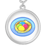 four colored eggs next blue oval.png custom necklace