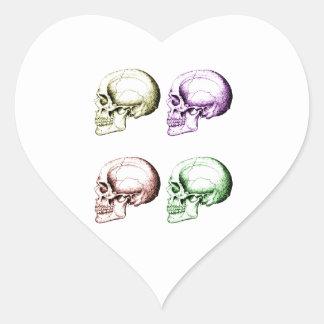 Four colored human skulls heart sticker