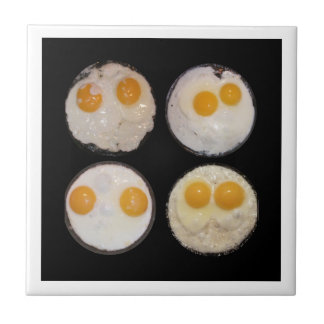 Four Egg Faces Ceramic Tile