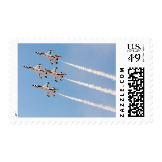 Four F-16 Thunderbirds fly in close formation Stamp