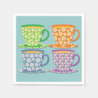 Four Flowery Tea Cups on Blue Paper Napkins