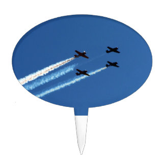 four flying planes with trails blue sky cake picks