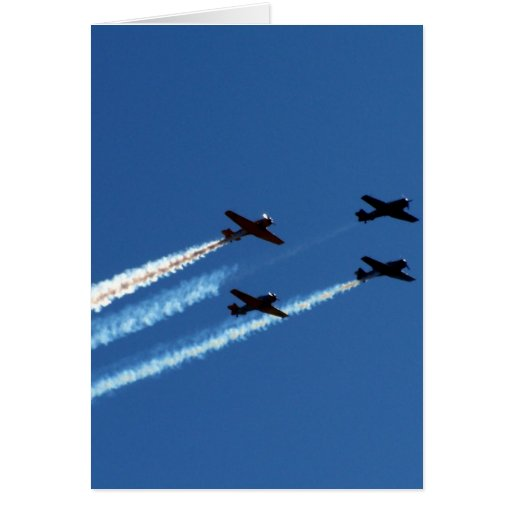 four flying planes with trails blue sky greeting card