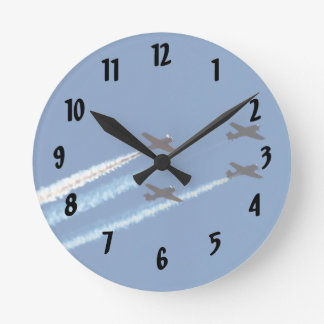 four flying planes with trails blue sky wall clocks