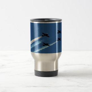 four flying planes with trails blue sky coffee mug