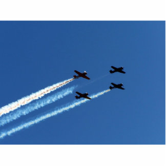 four flying planes with trails blue sky cut outs