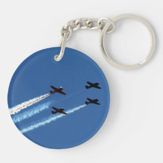 four flying planes with trails blue sky keychain