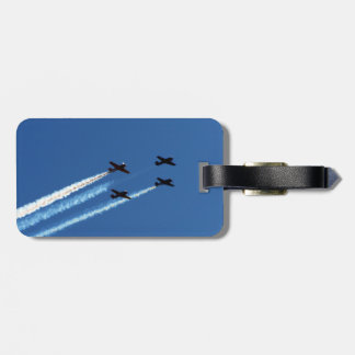four flying planes with trails blue sky luggage tags