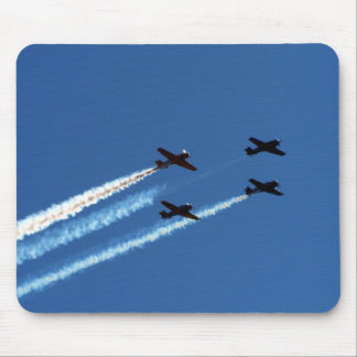 four flying planes with trails blue sky mousepads