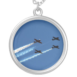 four flying planes with trails blue sky necklace