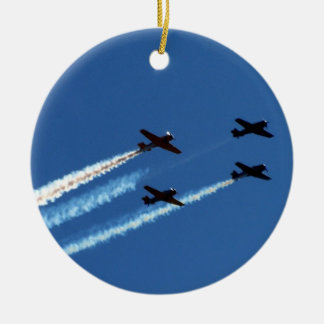 four flying planes with trails blue sky christmas ornaments