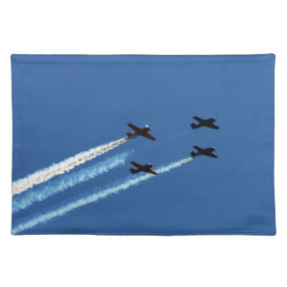 four flying planes with trails blue sky placemats