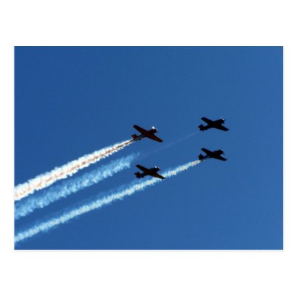 four flying planes with trails blue sky postcard