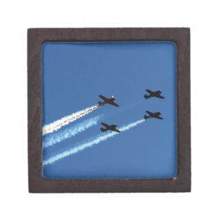 four flying planes with trails blue sky premium gift box