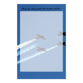 four flying planes with trails blue sky stationery