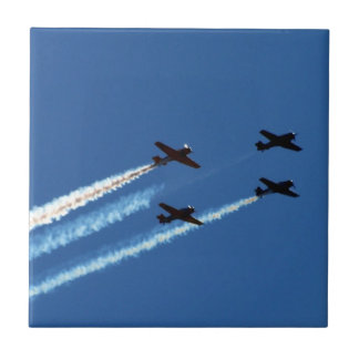 four flying planes with trails blue sky ceramic tile