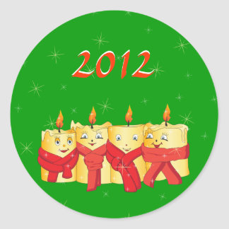 Four golden candles with red scarfs classic round sticker