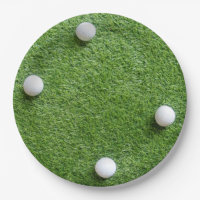 Four golf balls are on green grass paper plate