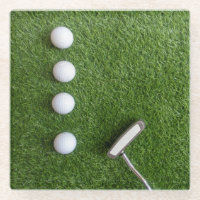 Four Golf balls with putter on green grass Glass Coaster
