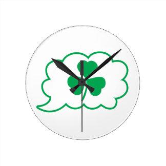 Four leaf clover Shamrock in a speech bubble Round Clock