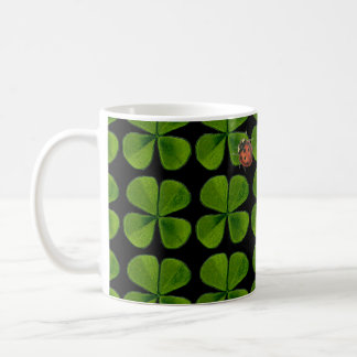 Four-leaf clovers and ladybug - black background coffee mug