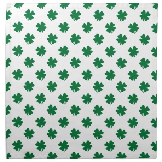 Four leaf clovers in green cloth napkin