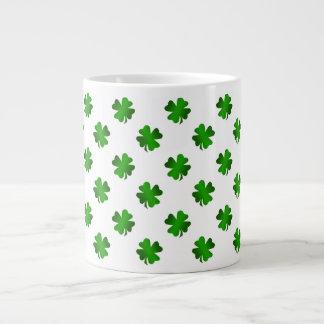 Four leaf clovers in green fade giant coffee mug