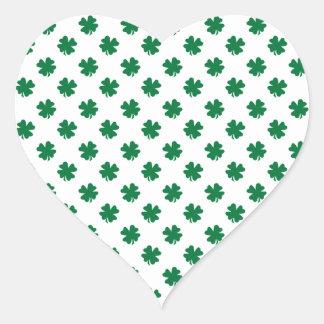 Four leaf clovers in green heart sticker
