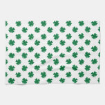 Four leaf clovers in green kitchen towel
