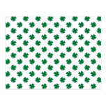 Four leaf clovers in green postcard