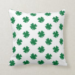 Four leaf clovers in green throw pillows