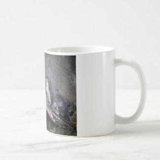 Four Little Penguins Coffee Mug