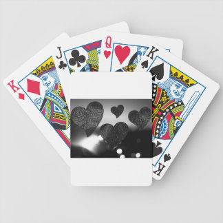 Four love hearts in silhouette night bokeh dof pho bicycle playing cards